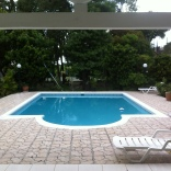 A view of the pool from a completed guest house in the back yard.