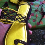 One finished sandal with it's match in the background.