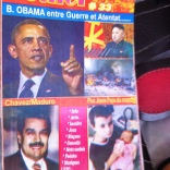 I wish I could read this. Obama, Chavez, Kim Jung Il, and some kid with a baby.